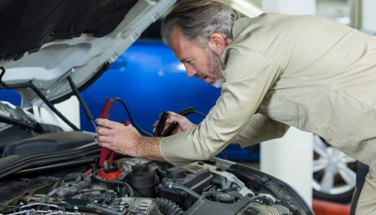 mechanic-attaching-jumper-cables-car-battery