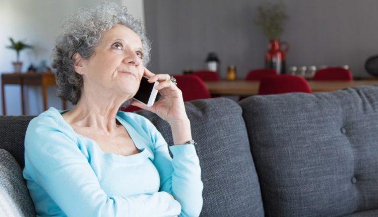 portrait-pensive-senior-woman-talking-mobile-phone